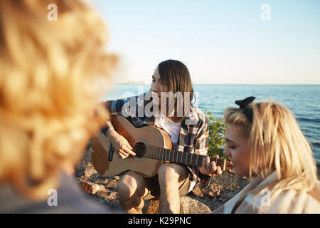 Friends Having Bonfire Party - Stock Photo
