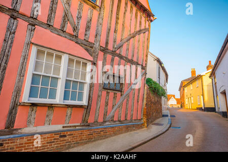 Lavenham Suffolk colour, exterior view of a medieval half-timbered pink house in Market Lane, Lavenham, Suffolk, - Stock Photo