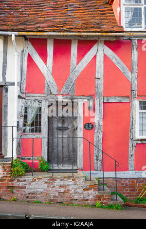 Lavenham Suffolk colour, exterior detail of the front of a medieval half timbered pink house in the Suffolk village - Stock Photo