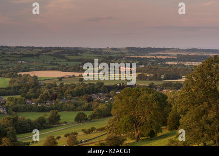 Sunset high view over sunlit Wharfe Valley, with Pool in Wharfedale village & Arthington viaduct in a scenic rural - Stock Photo