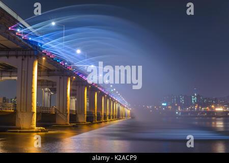 Seoul city skyline and Fountain at Banpo Bridge, Seoul, South Korea - Stock Photo