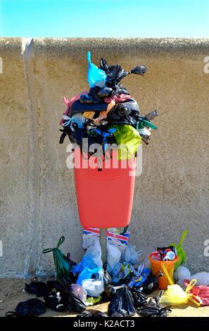 overflowing dog waste rubbish bin, hunstanton, norfolk, england - Stock Photo