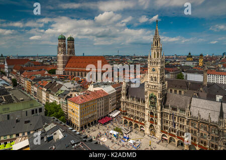 City skyline with Frauenkirche cathedral and new city hall or Neues Rathaus, Munich, Bavaria, Germany - Stock Photo
