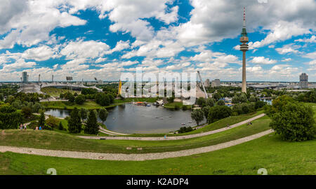 Panoramic view over the Olympic stadium and the Olympic tower or  Olympiaturm, Olympiapark, Munich, Bavaria, Germany - Stock Photo