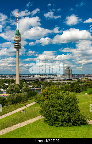Olympic Tower and BMW Tower in the background, Olympiapark, Munich, Bavaria, Germany - Stock Photo