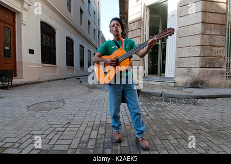 Street musician with guitar in old town Havana Cuba - Stock Photo