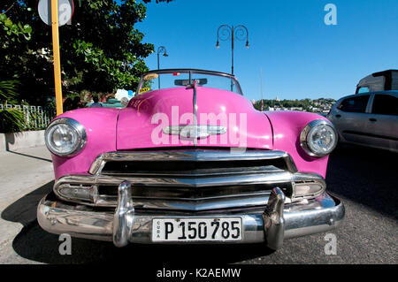Pink 1953 Chevy convertible taxi parked in Old Havana Cuba - Stock Photo