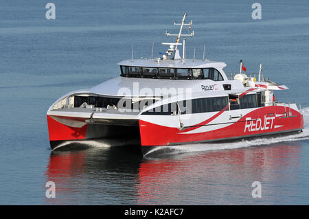 Red jet Isle of Wight ferry fast ferries Solent crossing to Isle of Wight red funnel shipping company or ferry companies - Stock Photo