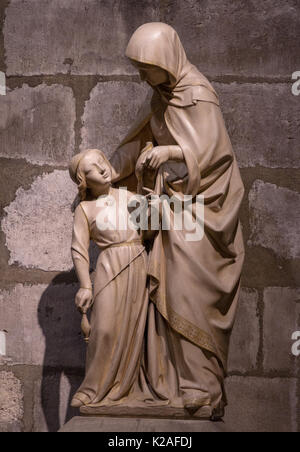 Historical landmark and touristic spot in Paris, France: Notre Dame cathedral interior detail - sculpture. - Stock Photo