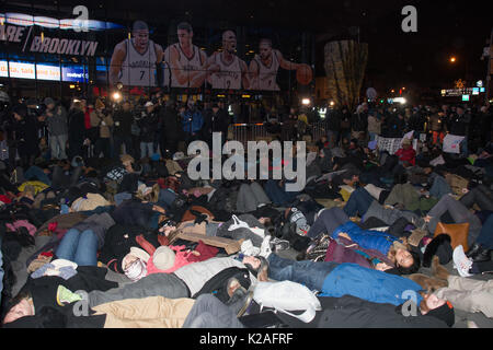 Black Lives Matter activists enact a die-in at Barclays Center protesting grand jury's non-indictment in Eric Garner - Stock Photo