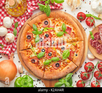 Delicious fresh pizza served on wooden table,top view. - Stock Photo