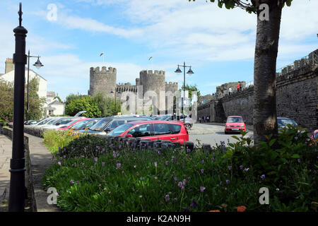 Conwy, Wales, UK. July 31, 2017. Conwy castle from inside the town wall with tourists walking the walls at Conwy - Stock Photo