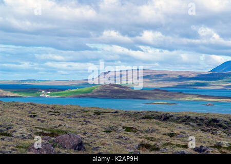 Typical Iceland morning seascape with farms in a fjord - Stock Photo