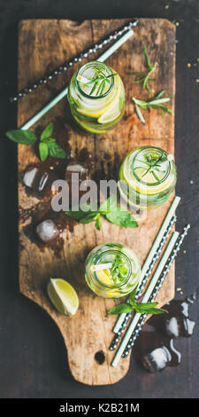 Dieting healthy infused citrus iced sassi water in glass bottles - Stock Photo