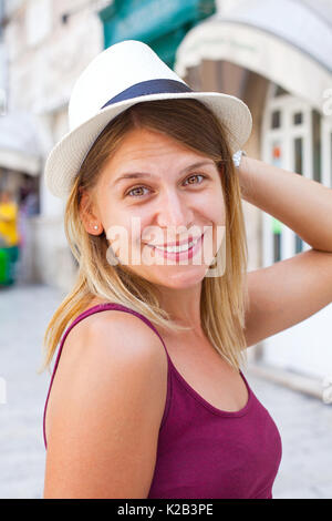 Portrait of a beautiful young female tourist in a summer vacation in Split old town, Croatia - Stock Photo