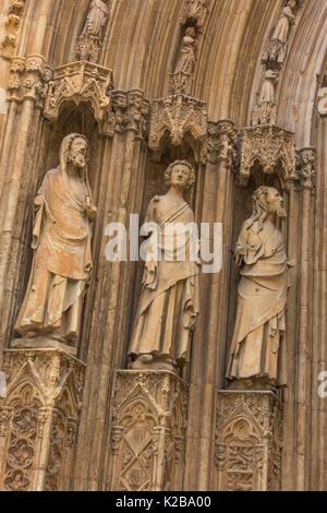 Plaza de la Virgen, Valencia, Spain.  Detail of the Apostle's Door or Puerta de los Apostoles, into the cathedral. - Stock Photo