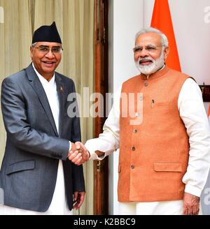 Indian Prime Minister Narendra Modi greets Nepalese Prime Minister Bahadur Deuba, left, at Hyderabad House August - Stock Photo