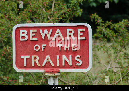 Old fashioned cast iron Beware of Trains sign - Stock Photo