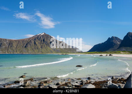 View along beautiful quiet sandy Skagsanden beach. Flakstad, Flakstadøya Island, Lofoten Islands, Nordland, Norway, - Stock Photo