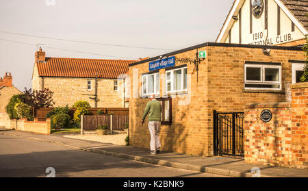 Old / senior man walking: Fit and trim elderly man taking a brisk, daily walk, in warm, early morning sunshine, - Stock Photo