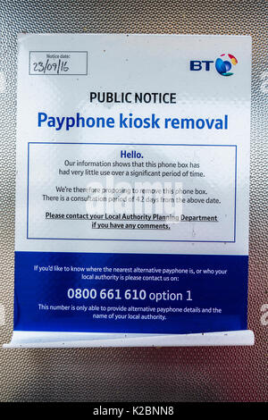 BT notice in a telephone box, stating the kiosk is to be removed after a consultation period due to lack of use. - Stock Photo