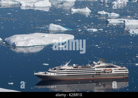 High angle view of  'Le Boreal' passenger vessel, from vantage point at Port Charcot, Booth Island, Antarctic Peninsula. - Stock Photo