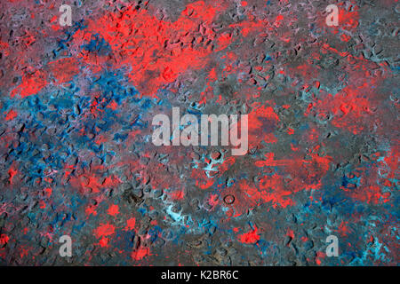 Notting Hill Carnival August  2017. Road surface marked with red and blue powder paint, the aftermath of Jouvert, - Stock Photo