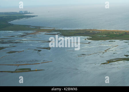 Aerial view of Steart Marshes Nature Reserve with Hinkley Point nuclear power station in background, Somerset, UK, - Stock Photo