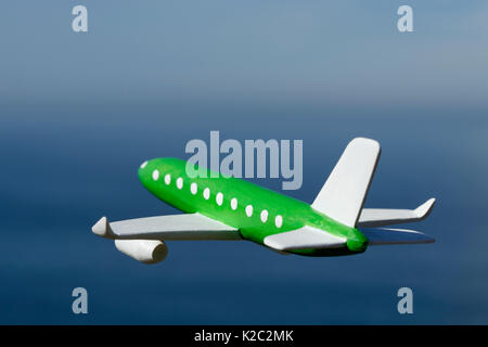 Model Aircraft with the ocean and sky in the background - Stock Photo