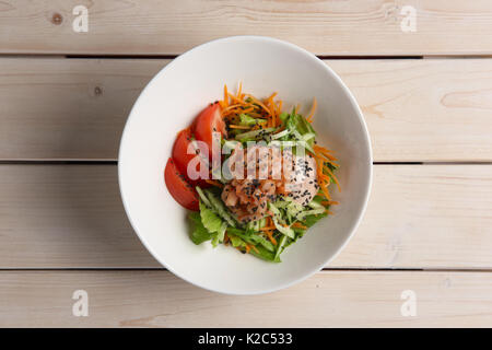 Salad with shrimps, cucumber, tomato and mustard sauce - Stock Photo