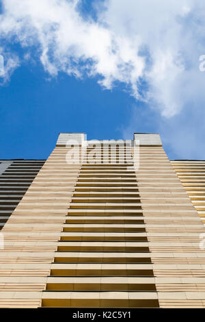 High-rise building modern architecture. Looking up blue sky white clouds, daylight urban landscape background, bottom - Stock Photo