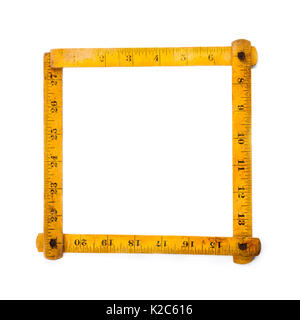Retro wooden carpenter ruler measure. measuring tools. square shape. on white background. copy space - Stock Photo