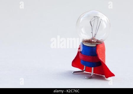 Light bulb super hero dressed in blue suit and red cape. Success man creative concept, fun, kind character. copy - Stock Photo