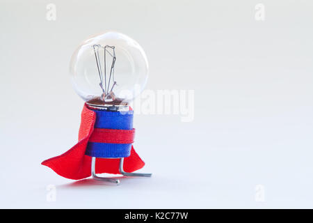 Light bulb in super hero costume. Skillful, expert man original concept. Vintage lamp with ideal spherical surface - Stock Photo