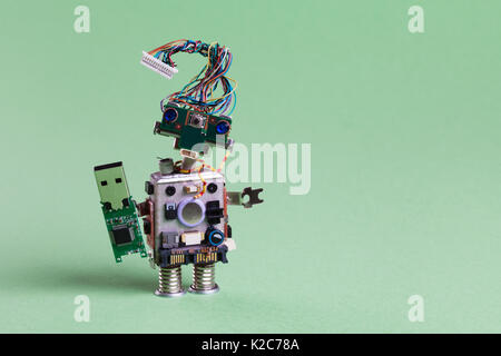Retro robot with usb flash storage stick. Data storing concept, stylish computer character blue eyed head, electrical - Stock Photo