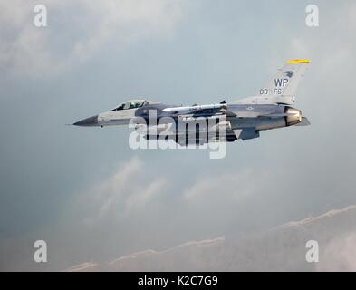 A U.S. Air Force F-16 Fighting Falcon fighter aircraft flies above the Kunsan Air Base August 10, 2017 in Gunsan, - Stock Photo