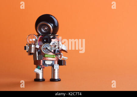 Vintage design robot character with lamp bulb. Circuits socket chip toy mechanism, funny black helmet head. Copy - Stock Photo