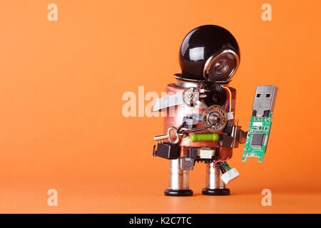 Robot with usb flash storage stick. Data storing and robotic technology concept, fun toy character black helmet - Stock Photo