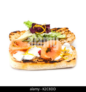 Red fish toast with salads and cheese sauce. Classic mediterrian food salmon sandwich grilled bread, marinated meat, - Stock Photo