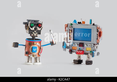 Robots repair service concept. Handyman mechanic worker with screw driver and robot monitor computer head. Error - Stock Photo