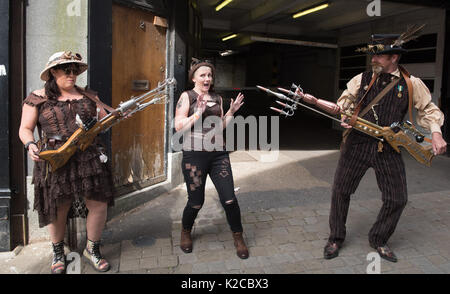 Lincoln, Lincolnshire, UK. 26th August 2017. Pictured: Fooling around with Steampunk weaponry.  /  Thousands of - Stock Photo