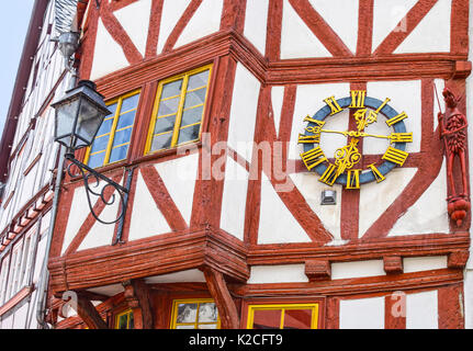 LIMBURG, GERMANY - MAY 11, 2017: Half-timbered house with clock and carved wooden figure in Limburg an der Lahn, - Stock Photo