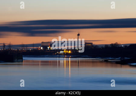 09/03/2016 Golden ball in & Heysham Power Station with river lune - Stock Photo