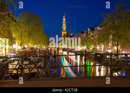 Westerkerk on the Prinsengracht Canal in Amsterdam at Twilight, the Netherlands. - Stock Photo