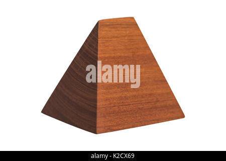 Small clean handmade decorative wooden brown geometric pyramid on isolated white background. - Stock Photo