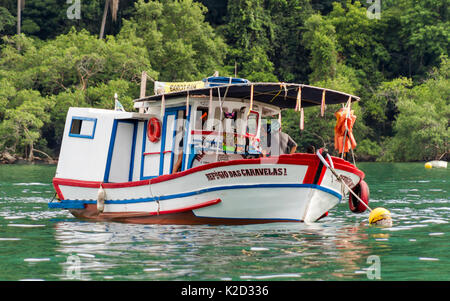 Angra dos Reis, RJ, Brasil: February 26, 2017: Fishing Boat transformed in a Bar to supply food and drinks to other - Stock Photo