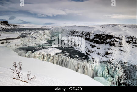 Partially frozen Gullfoss waterfall on the Hvita River, Southern Iceland, March 2015. - Stock Photo