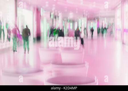 Abstract defocused motion blurred unrecognizable walking young people in the shopping center, urban lifestyle, shopping - Stock Photo