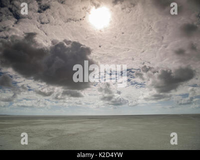 Beach at low tide with sun behind clouds, Crotoy, Somme Bay, Pas De Calais, France, July 2015. - Stock Photo