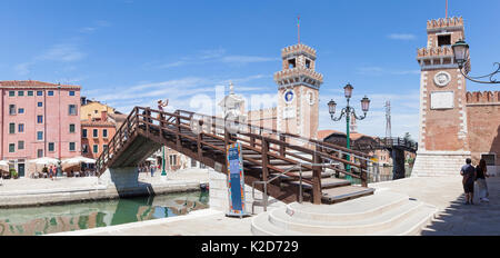 Panorama view of Arsenale and the Ponte de l'Arsenale o del Paradiso, Venise, Italy with a woman tourist standing - Stock Photo